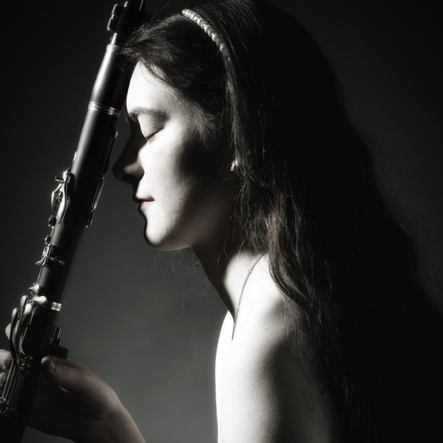 """Portrait of Young Female Musician with Clarinet"" stock image"