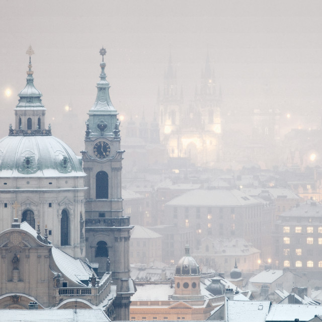 """""""Prague - St. Nicholas church and spires of the Old Town during snowfall"""" stock image"""