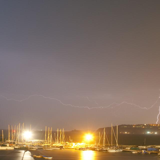 """""""Lightning over Marina Grande, Procida Island, Bay of Naples, Campania, Italy"""" stock image"""