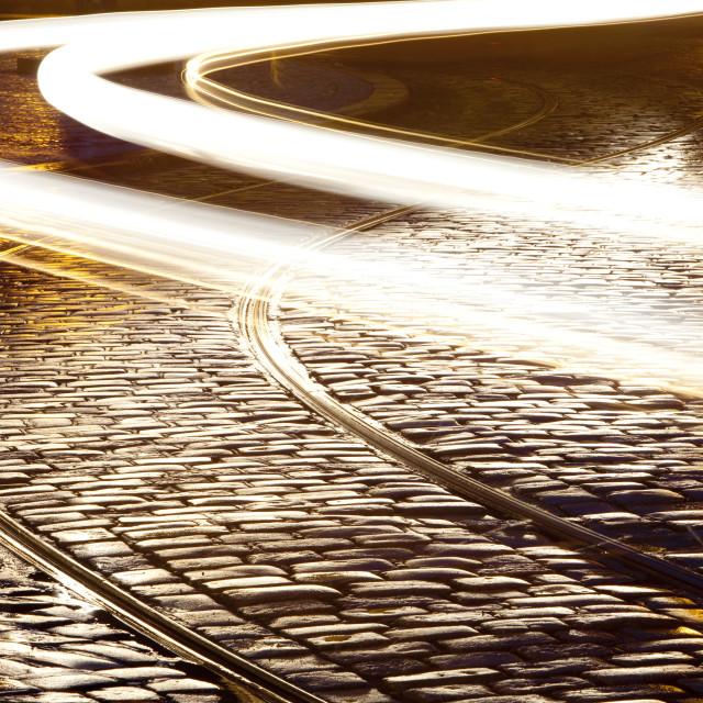 """prague - tram tracks and cobblestone street at dusk after rain"" stock image"