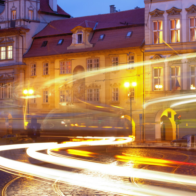 """Prague - cars and tramways at Malostranske Square at dusk"" stock image"