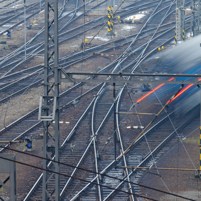 """fast train passing in high speed - blurred motion - view from above"" stock image"