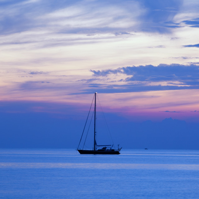 """croatia, adriatic sea - anchored sailboat at dusk"" stock image"