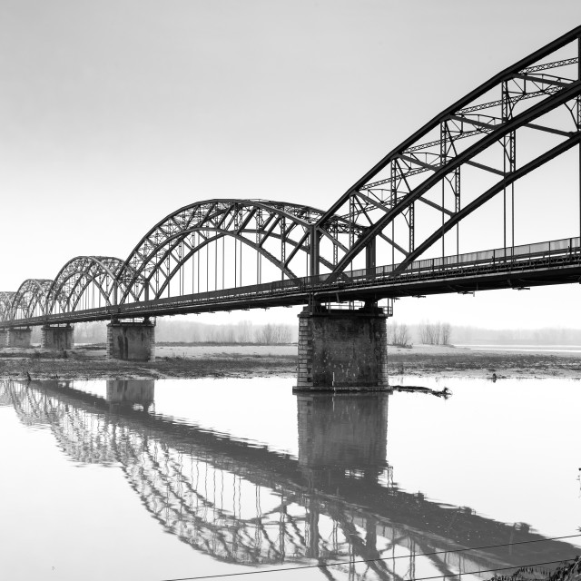"""The ""Gerola"" iron bridge, on the Po river. Black and white photo"" stock image"