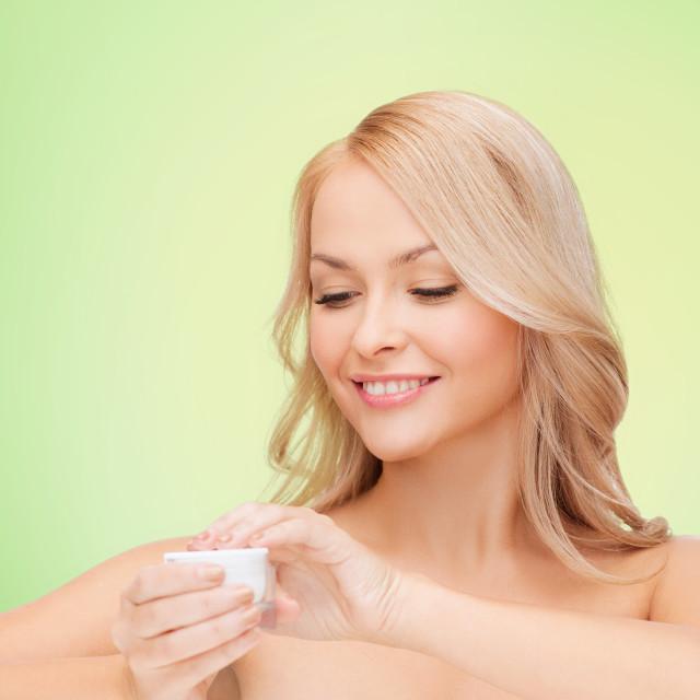 """beautiful woman applying cream"" stock image"