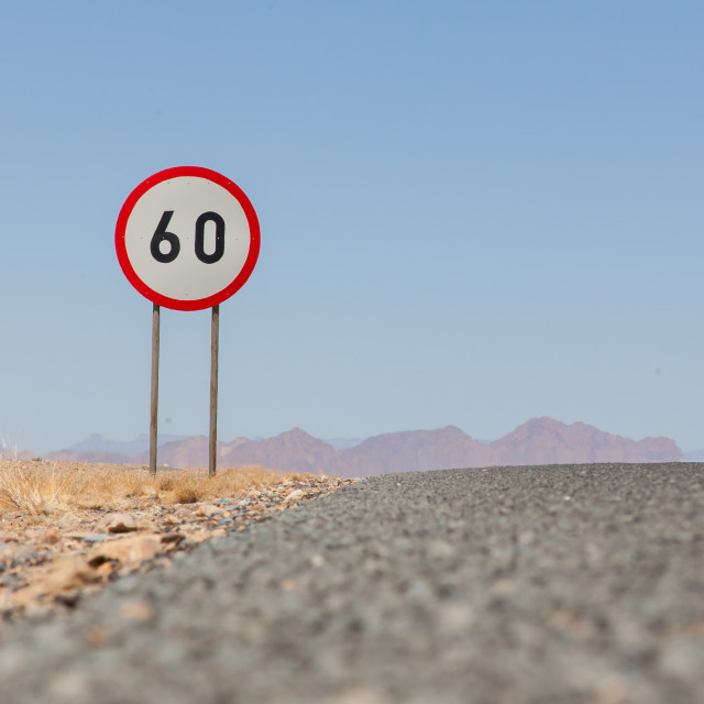 """Speed limit sign at a desert road in Namibia"" stock image"