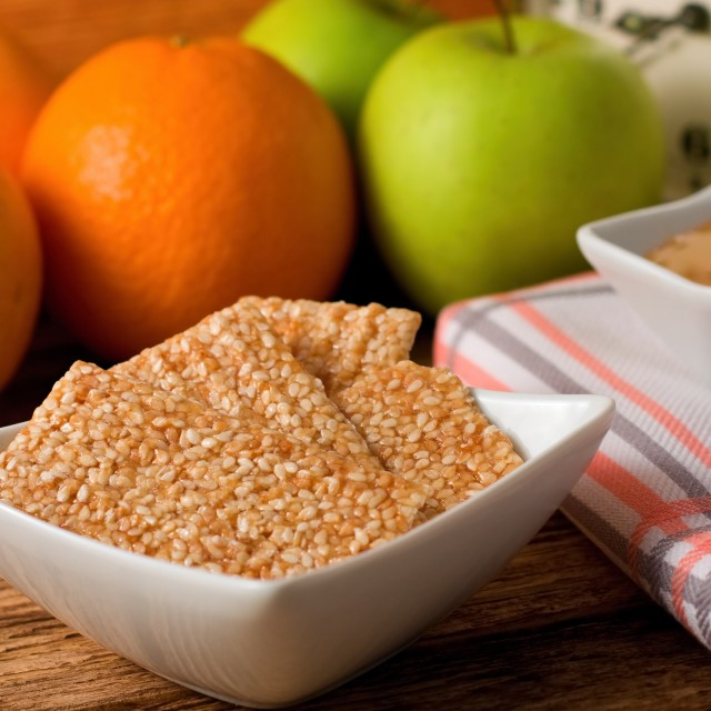 """Biscuits from sesame seeds and honey and fruit in background"" stock image"
