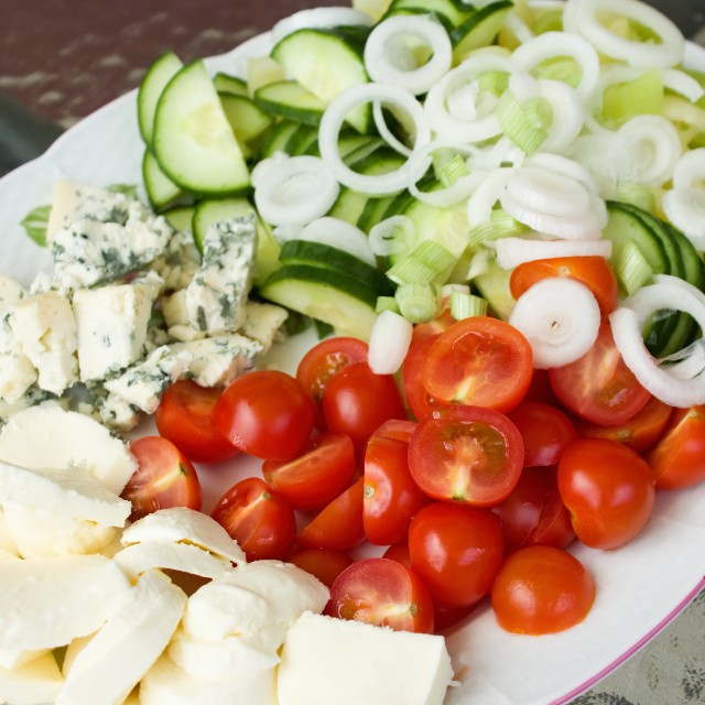 """Big oval plate with various vegetable and cheeses"" stock image"