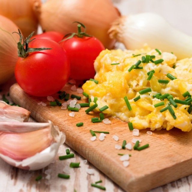 """Breakfast with scrambled eggs and tomatoes"" stock image"