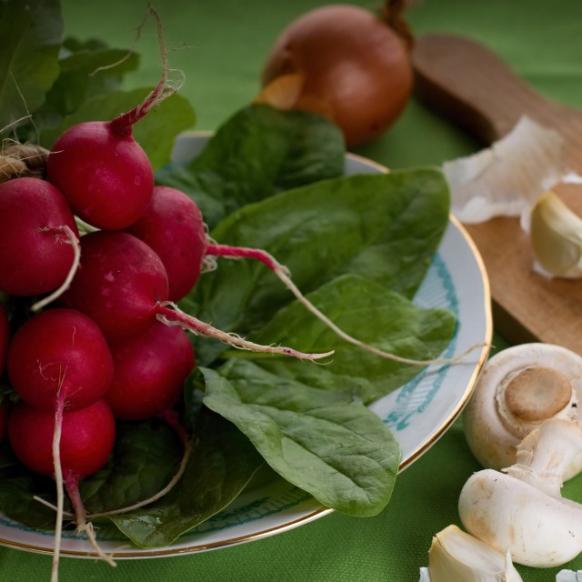 """Bunch on radishes plus spinach and mushrooms"" stock image"