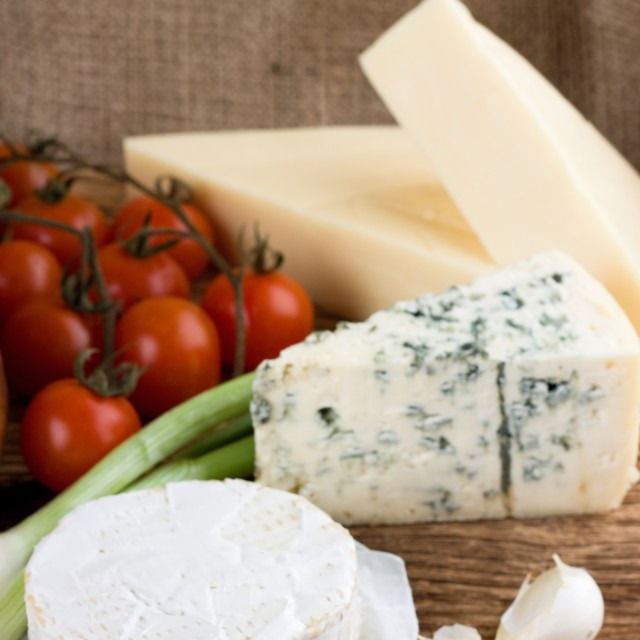 """Camembert cheese in front of danish blue and eidam"" stock image"