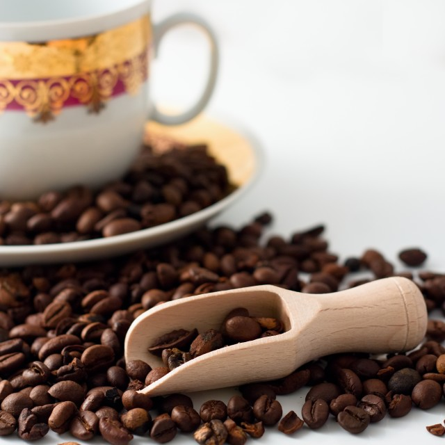 """Coffee grains, wooden spoon and white cup"" stock image"