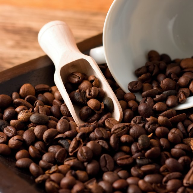 """Coffee grains on tray from dark wood and spilled cup"" stock image"
