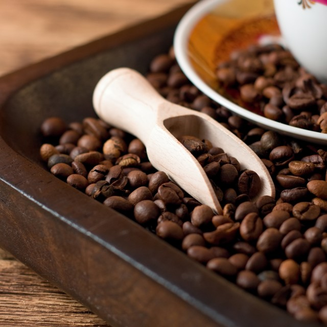 """Coffee grains on tray from dark wood"" stock image"