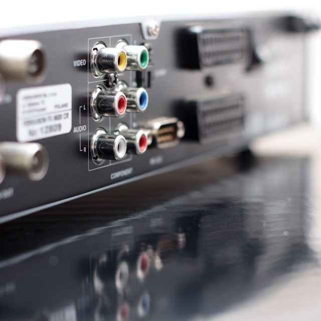 """Colored connectors on back side of DVD player"" stock image"