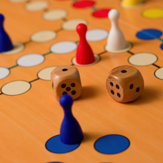 """Couple of wooden dices on Ludo board"" stock image"