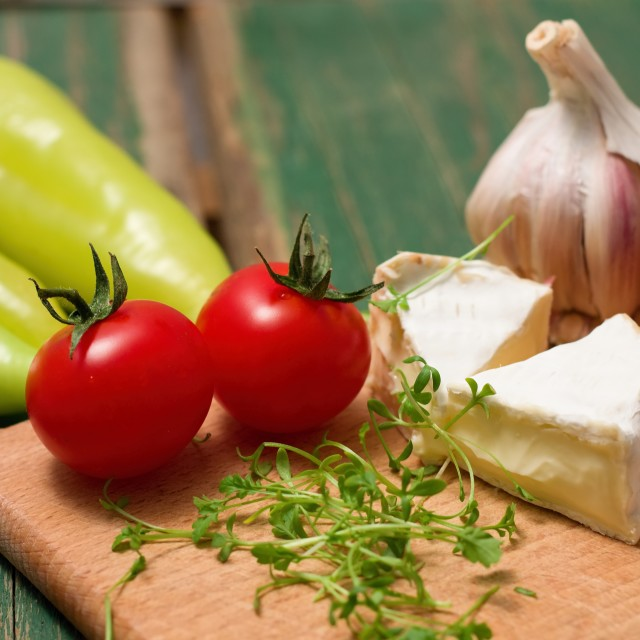 """Cress, Camembert and tomatoes on chopping board"" stock image"