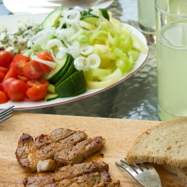 """Cut pork steak with vegetable on garden party"" stock image"