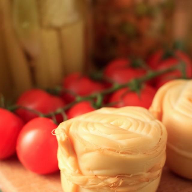 """Detail of Parenica smoked cheese and tomato shrub"" stock image"