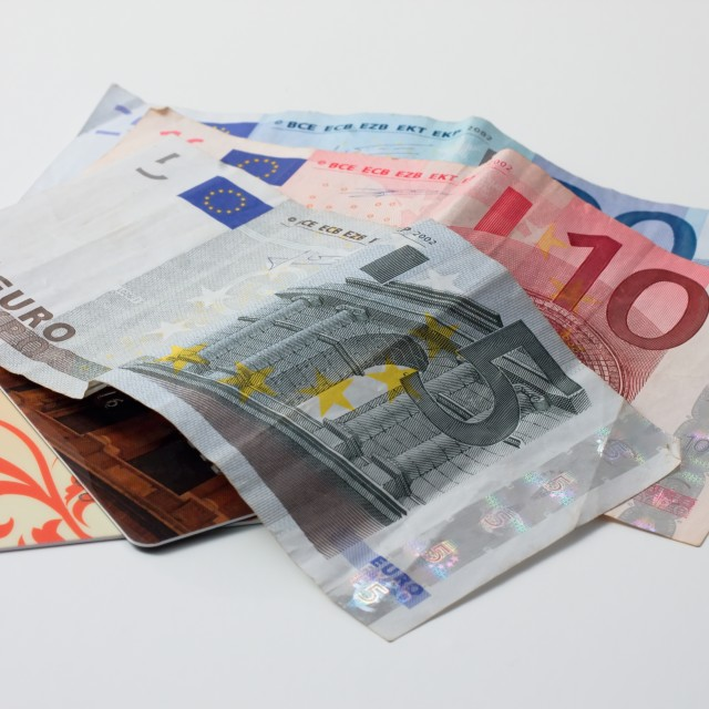 """Euro bills and credit cards on white background"" stock image"
