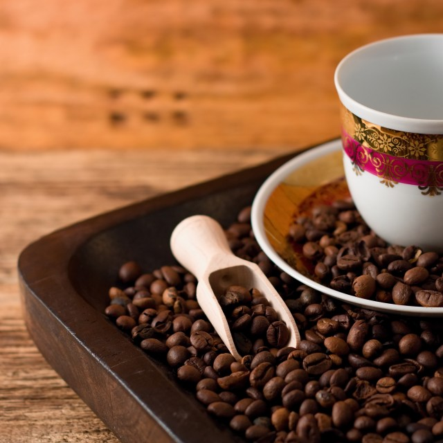 """Empty cup and coffee beans in wooden tray"" stock image"