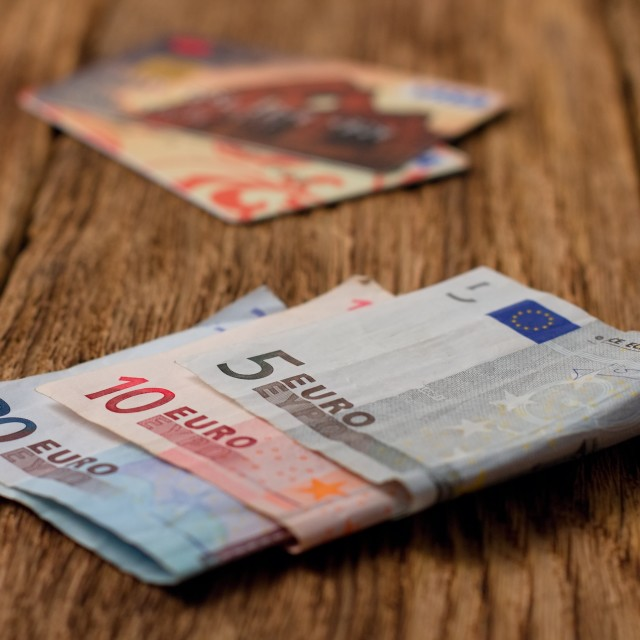 """Euro bills on wooden board with credit cards in background"" stock image"