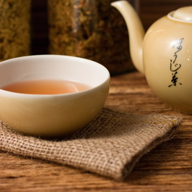 """""""Chinese tea in cup with kettle on right"""" stock image"""