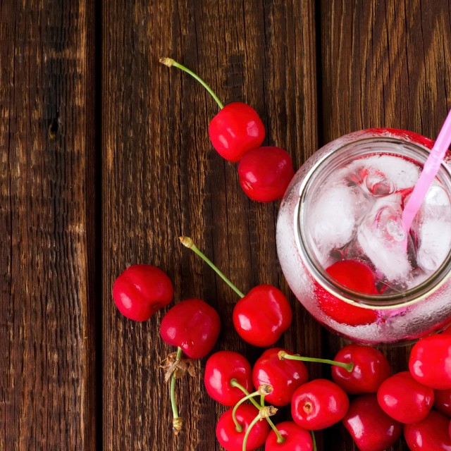 """""""Jar with cold drink with many cherries around"""" stock image"""