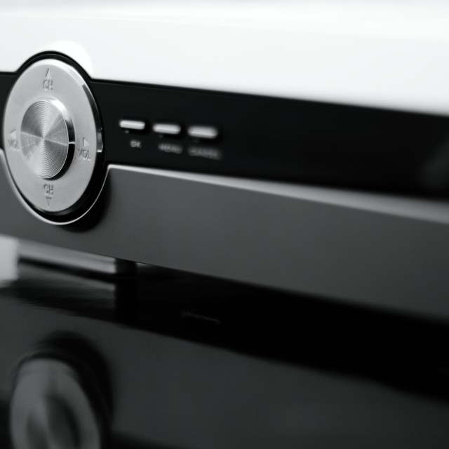 """Silver volume controller on front side of DVD player"" stock image"