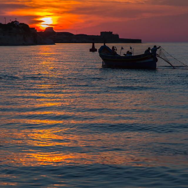 """Fishing at sunset"" stock image"