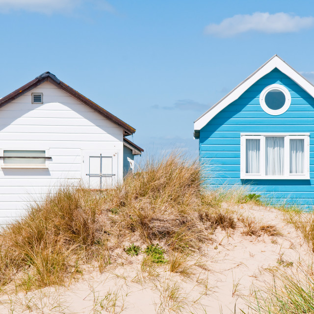 """Blue and White Beach Huts"" stock image"