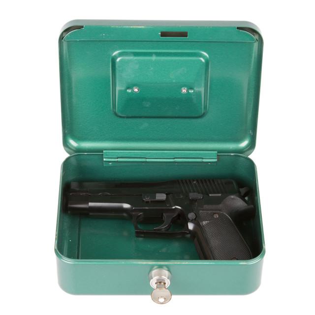 """9mm pistol in a metal case"" stock image"