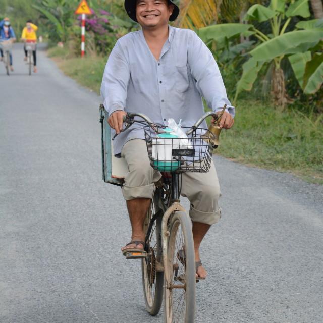 """Happy Man on a bike"" stock image"