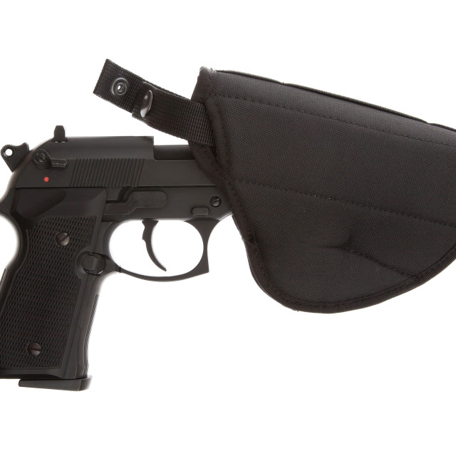 """""""9mm Pistol in a flexible holster"""" stock image"""