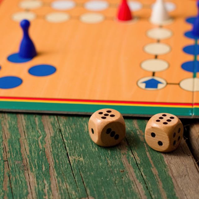 """Two wooden dices in front of ludo with figurines"" stock image"