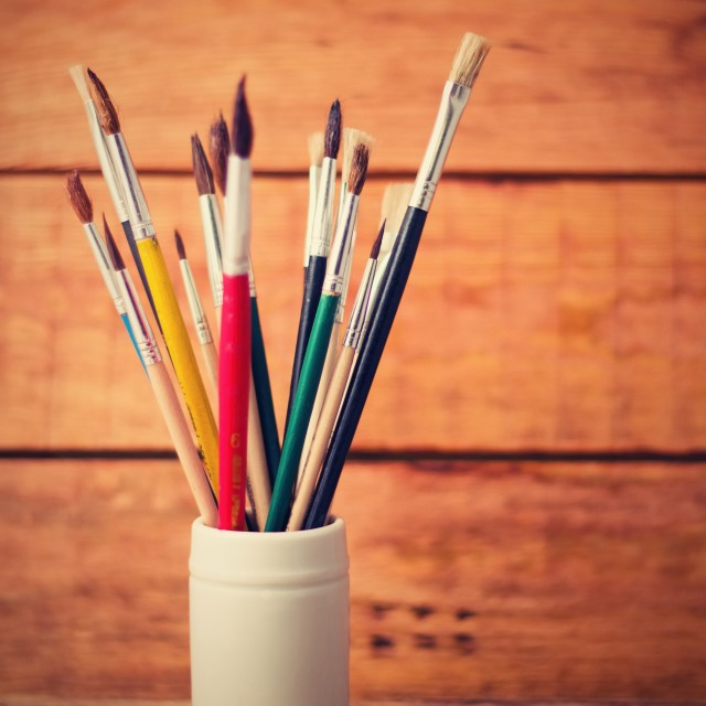 """""""Vintage vertical retro photo of jar with paintbrushes"""" stock image"""