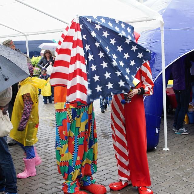 """Clowns in the rain"" stock image"