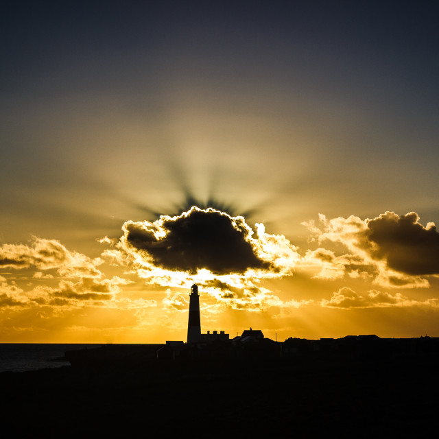 """Lighthouse at Sunset"" stock image"