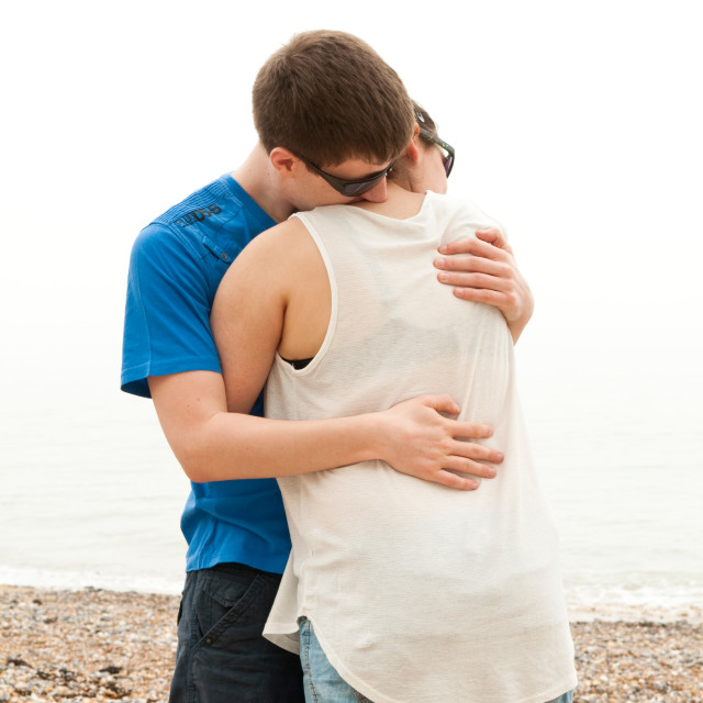 """Young couple hugging"" stock image"