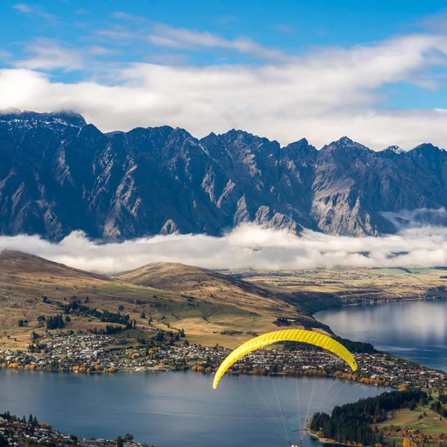 """""""Paraglider over Queenstown"""" stock image"""