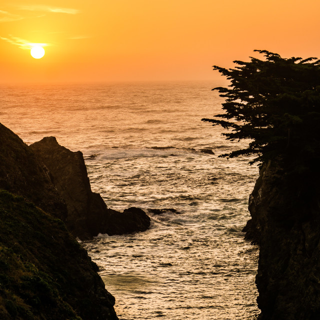 """Sunset Over the Rocky California Coast"" stock image"