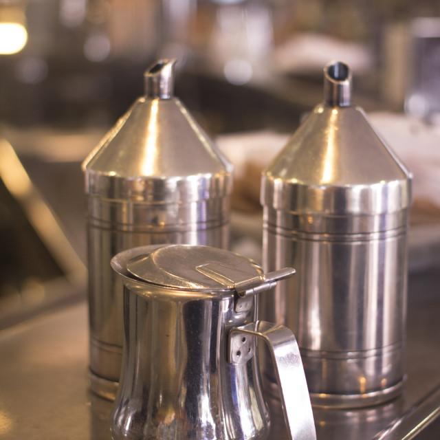 """Coffee sugar milk dispensers in cafe bar"" stock image"