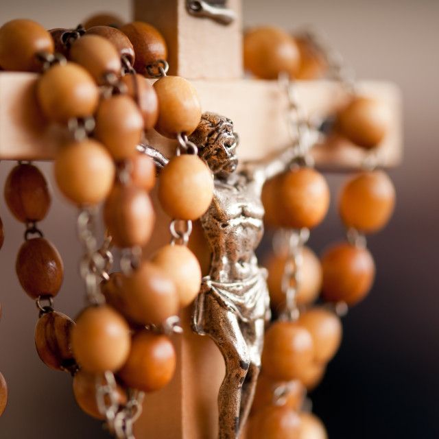 """Wood rosary and Jesus figurine"" stock image"