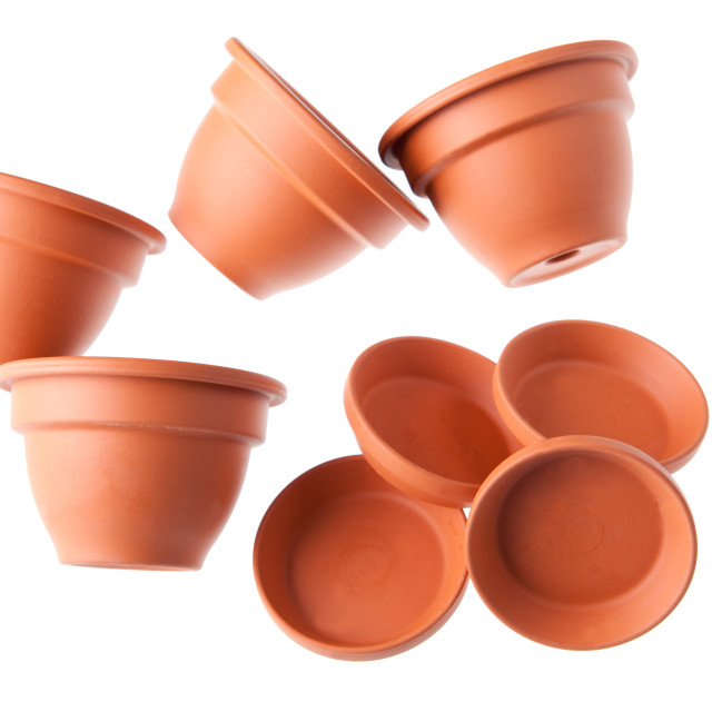 """Four scattered clay flowerpots with saucers"" stock image"