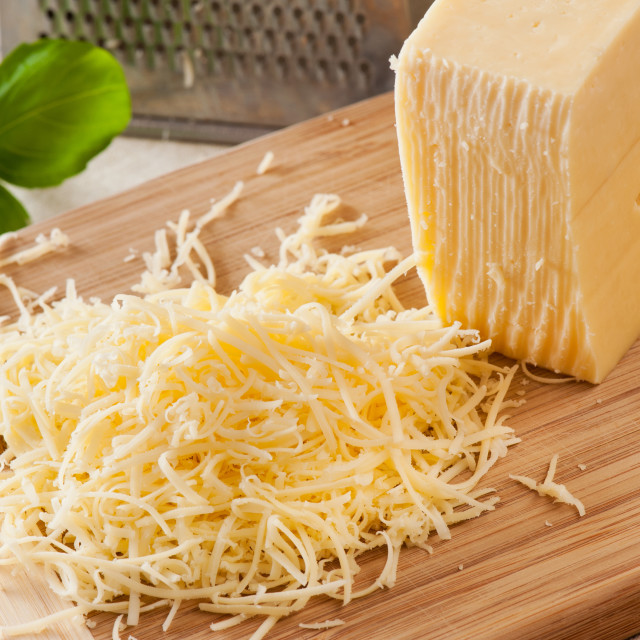 """""""shredded yellow cheese and whole cheese"""" stock image"""