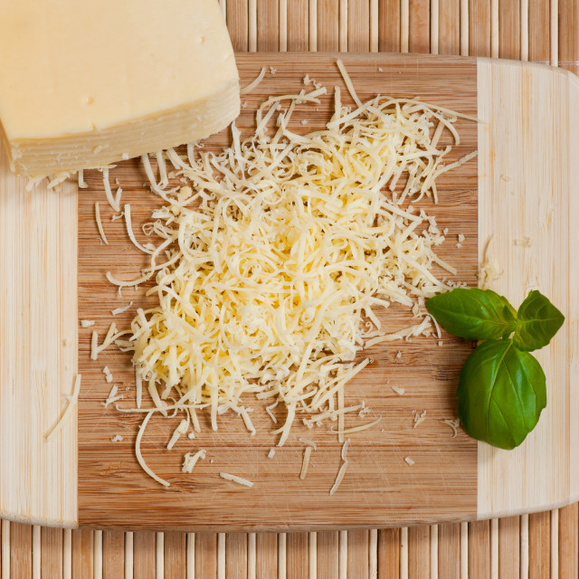 """""""Grated yellow cheese and whole cheese portion"""" stock image"""