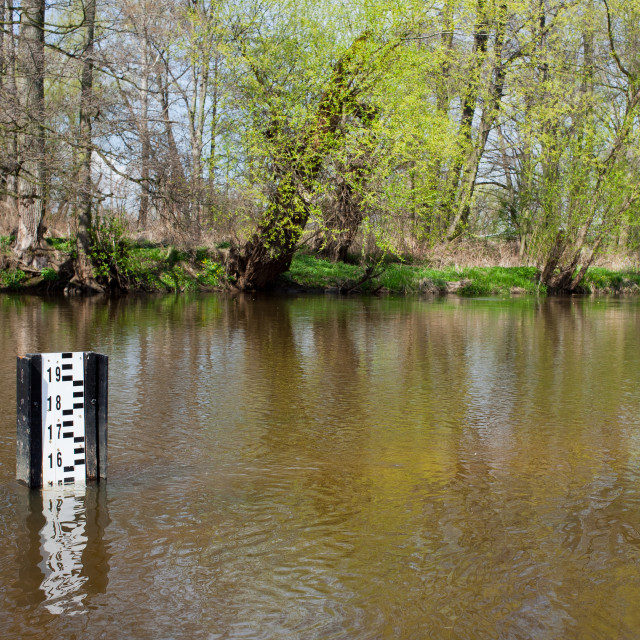"""""""Water flood gauge depth marker in small river"""" stock image"""