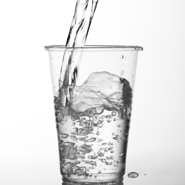 """water filling transparent expendable cup"" stock image"