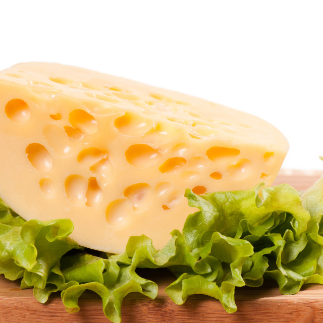 """One yellow cheese with holes portion"" stock image"