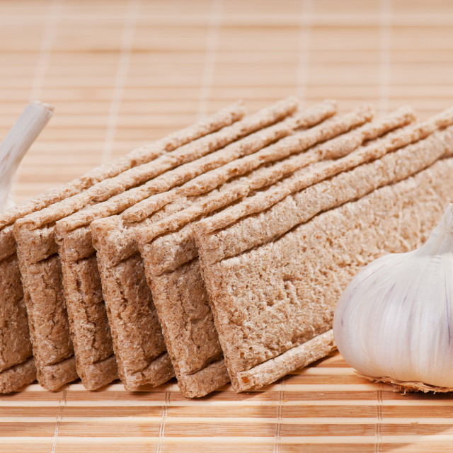 """dry crisp bread slices with garlic bulbs"" stock image"